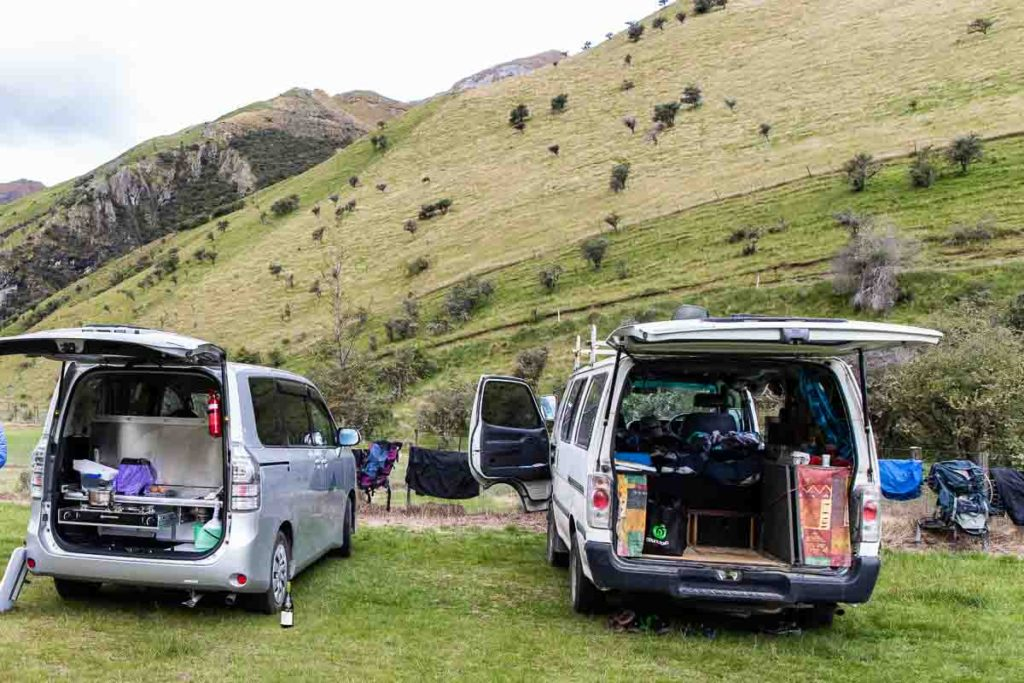 Two vans in a campground in New Zealand